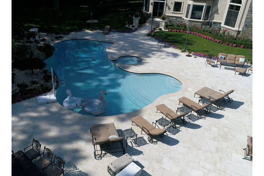 The advantages of using marble or travertine for pool copings, pool areas, decks and patios: